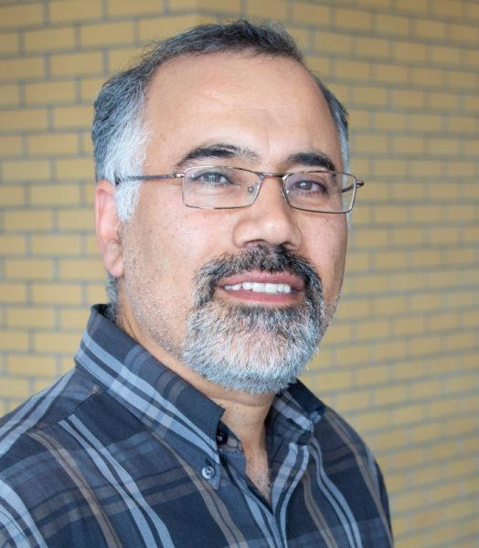 Headshot of prof Ali Asgary