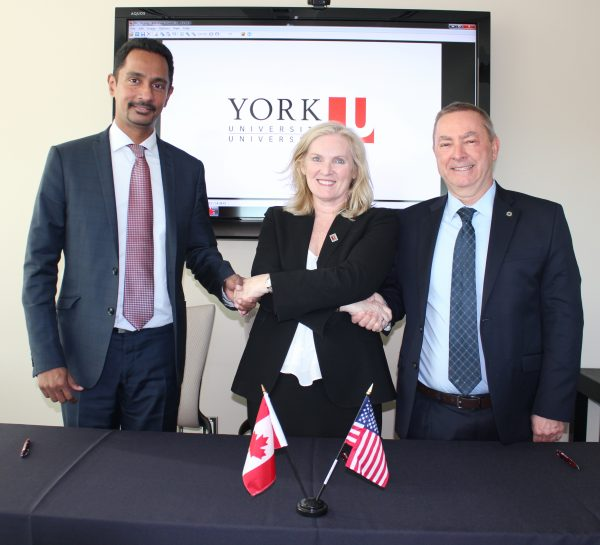 From left, Dean of York U's Faculty of Science Ray Jayawardhana, President and Vice-Chancellor of York U Rhonda Lenton and Nigel Lockyer, Director of Fermilab
