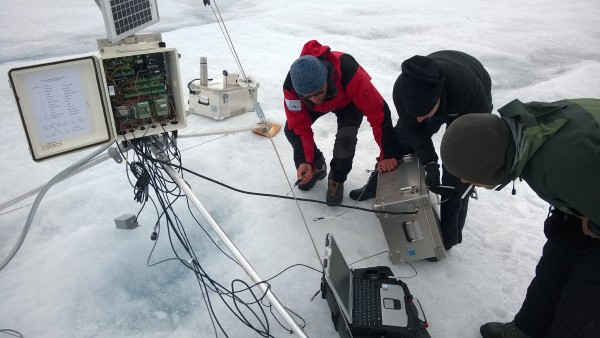 Researchers service one of PROMICE's automatic weather stations on the Greenland ice sheet that was used in the study. Photo by William Colgan, York University