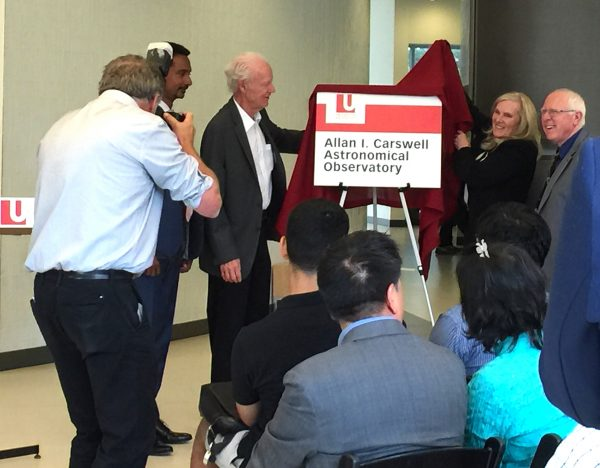 From left, Faculty of Science Dean Ray Jayawardhana with York U Professor Emeritus Allan Carswell, President and Vice-Chancellor Rhonda Lenton and Univeristy Professor Paul Delaney unveil the sign in Allan Carswell's honour for the new Allan I Carswell Astronomical Observatory.