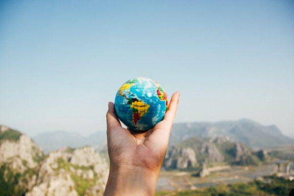 person holding world globe