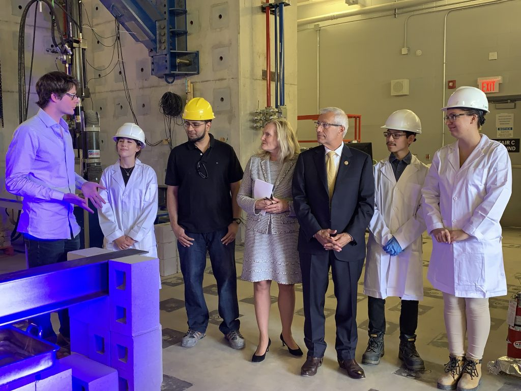 Ontario MPP Victor Fedeli watches as Lassonde School of Engineering Professor John Gales demonstrates fire testing during a visit to York University's High Bay Structure Lab for an Ontario Government research funding announcement.